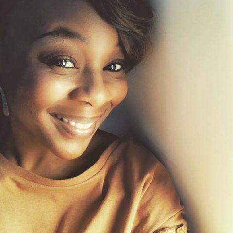 Shajuan Simmons, smiling